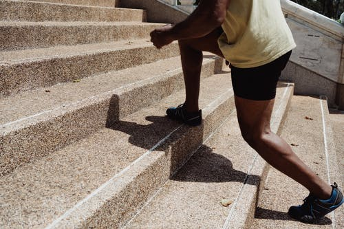 Person Skipping Steps on the Stairs