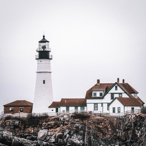 Lighthouse and houses on cliff