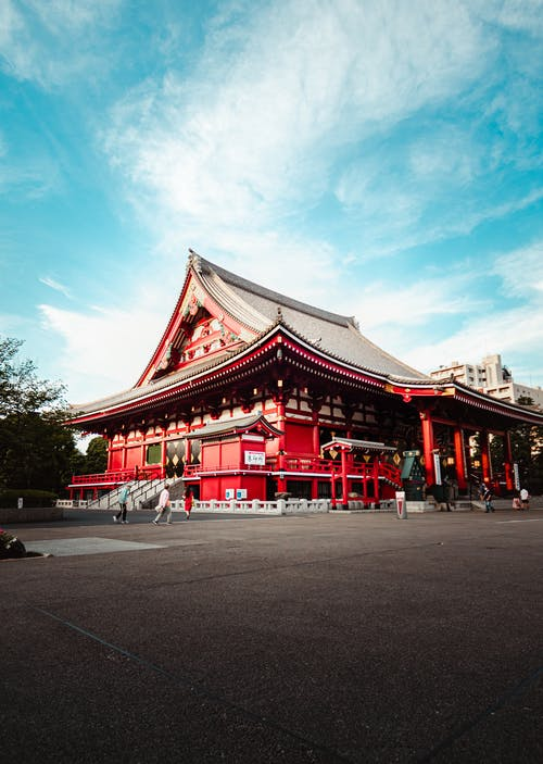 Red and White Temple Under Blue Sky