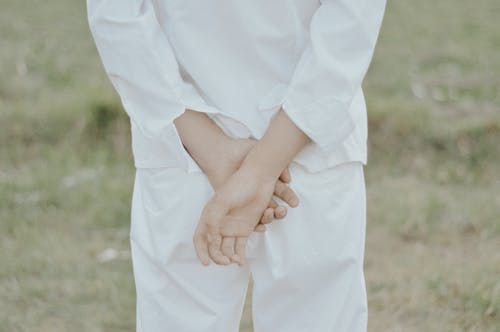Person in White Dress Shirt and White Pants