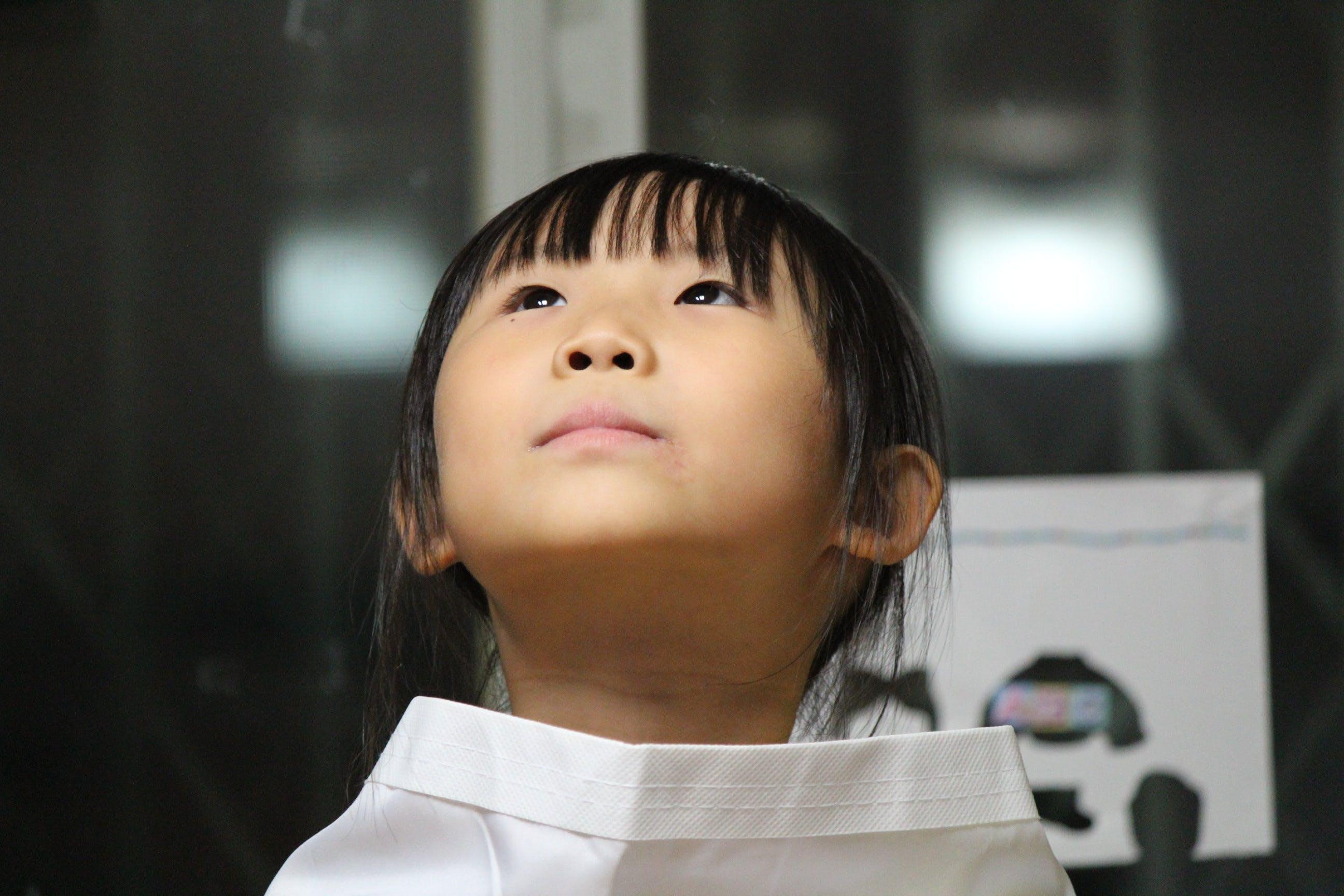 Black Haired Girl on White Shirt