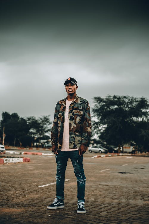 Cool hipster black man on street in cloudy day