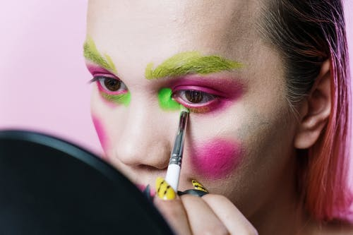 Woman With Pink and Green Face Paint