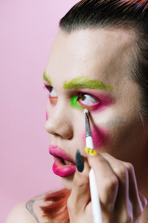 Woman With Pink Lipstick Holding Pen