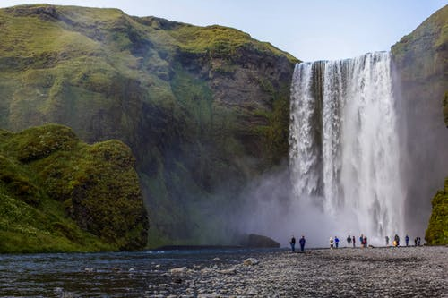 People Looking At A View of Waterfalls