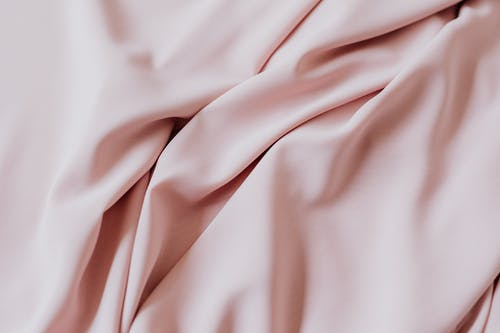 Pink Textile on Brown Wooden Table