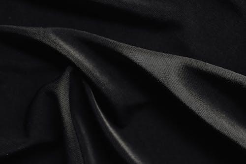 Black Textile on White Textile