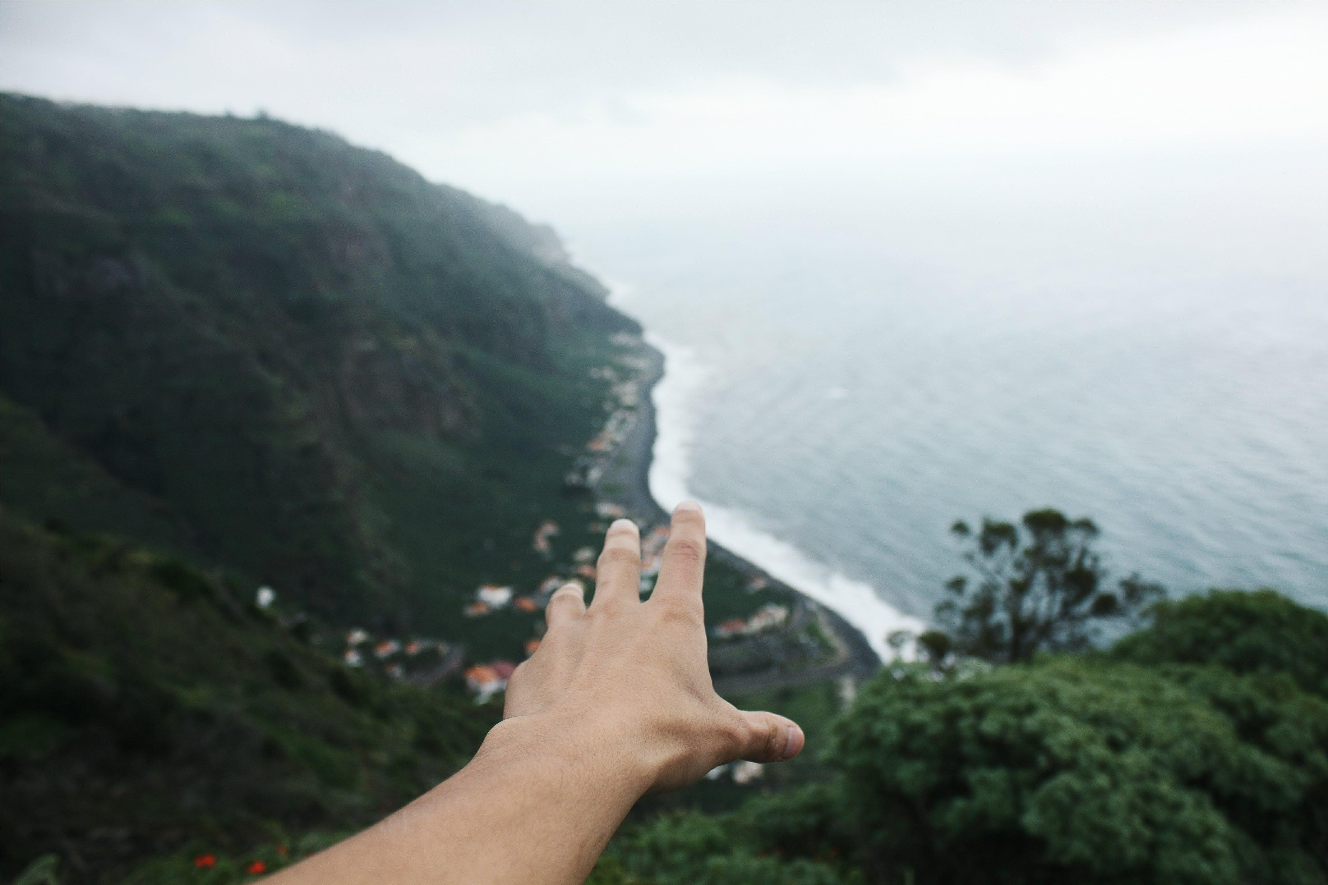 Free stock photo of hand, water, ocean, coast