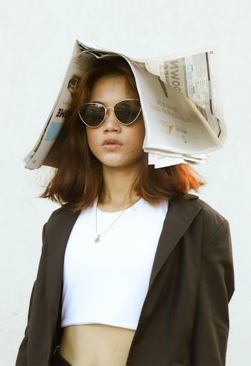 Woman in White Shirt and Black Blazer Wearing White Framed Sunglasses