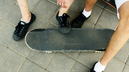Person Wearing Black Nike Sneakers