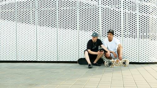 2 Men Sitting on Floor