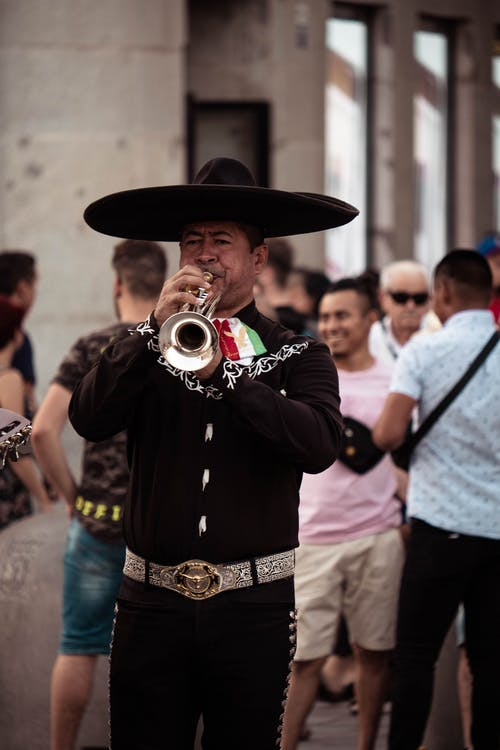Man in Black Button Up Shirt Playing Trumpet