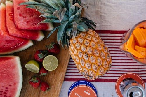Pineapple Fruit Beside Sliced Strawberries