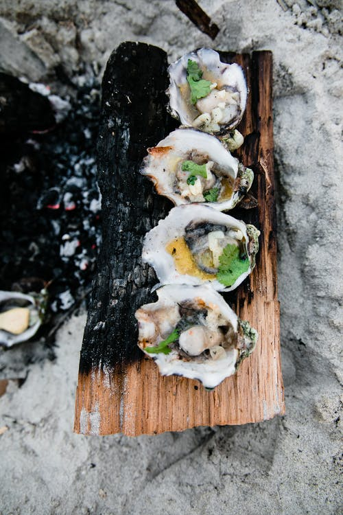 Oysters cooked on fire on beach
