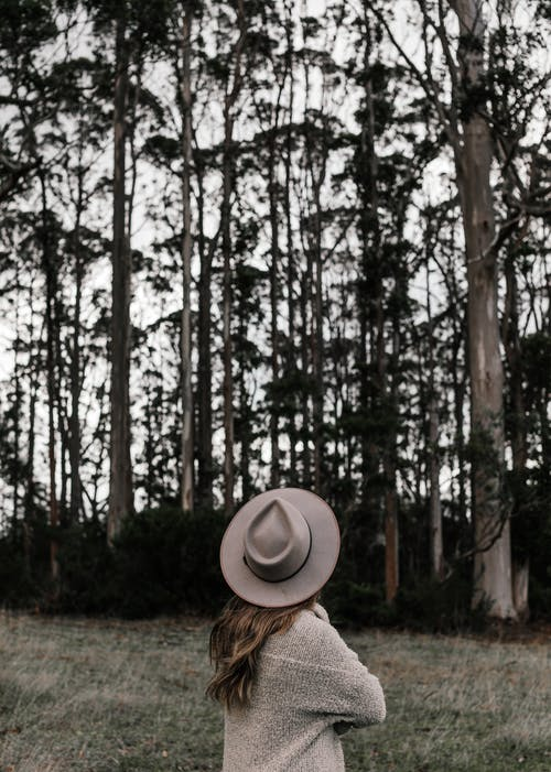Lonely woman walking in forest