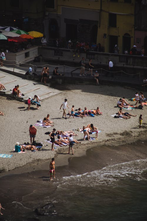 People resting on sandy beach