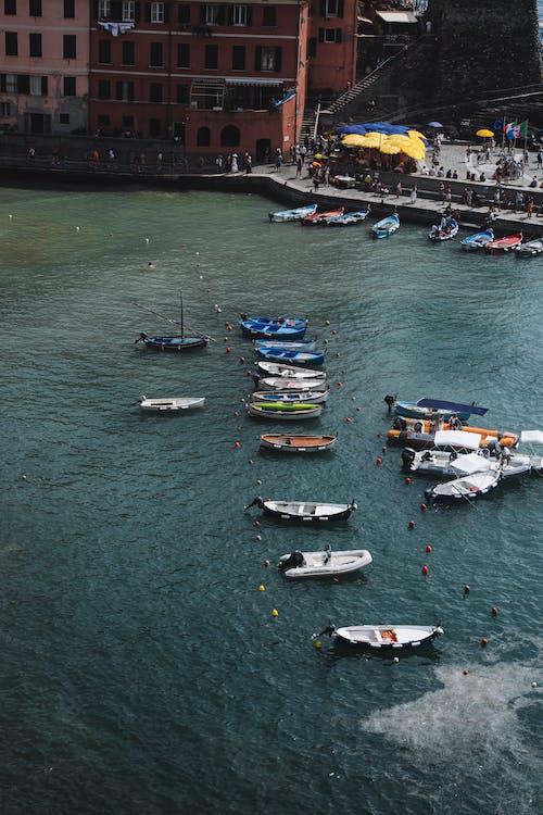 Boats on sea water near pier