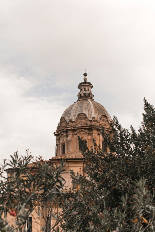 Old cathedral facade with dome