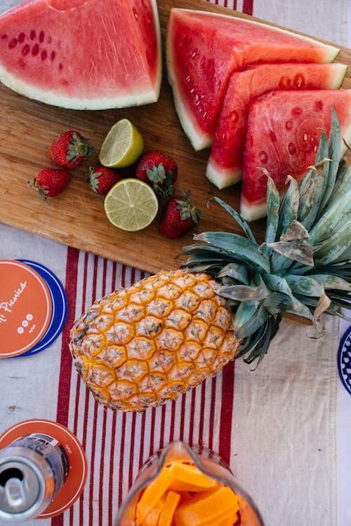 Sliced fresh fruits on table