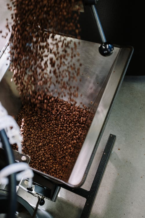 Brown and Black Coffee Beans on Stainless Steel Tray