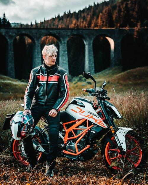 Gratis stockfoto met bestuurder, biker, boogbrug