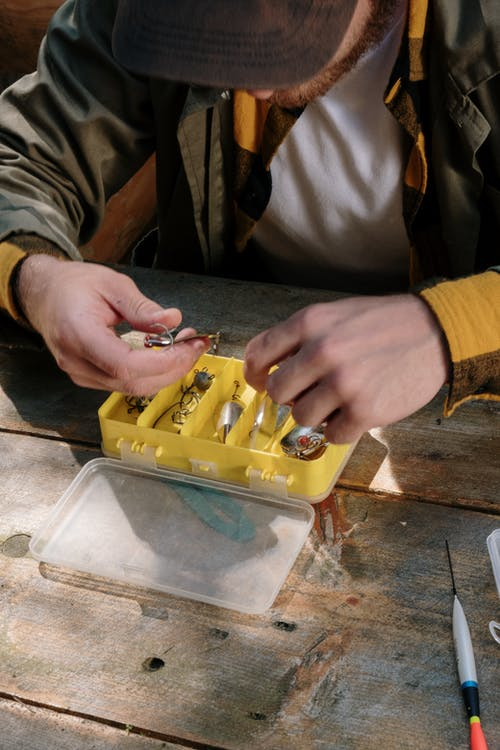 Person Holding Yellow Plastic Tool