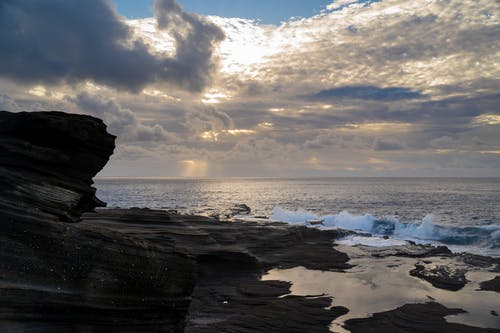 Brown Rock Formation on Sea Shore