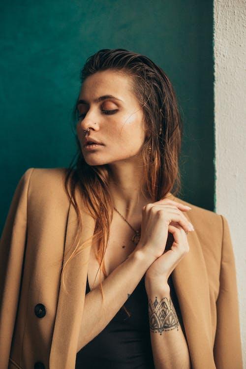 Woman in Brown Long Sleeve Shirt