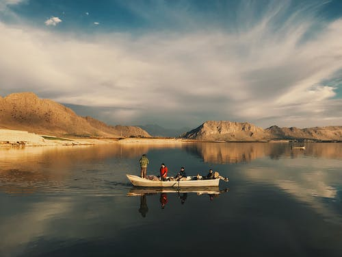 2 Person Riding on White Boat on Lake