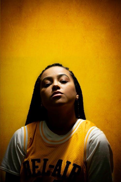 Arrogant black woman against yellow wall