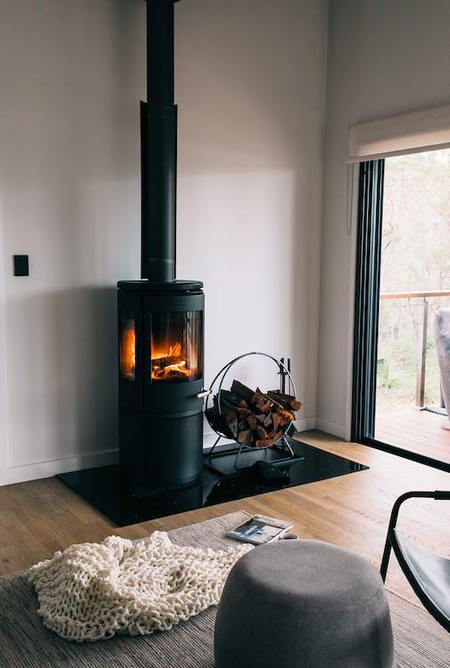 Cozy fireplace in light minimalist living room