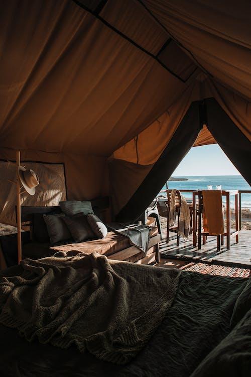 Cozy tent interior on exotic shoreline