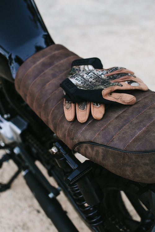 Motorbike with gloves parked on road