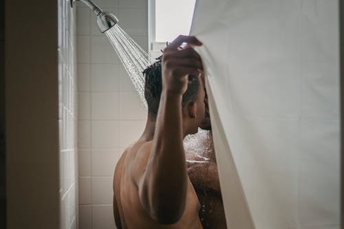 Two Men Kissing in the Shower
