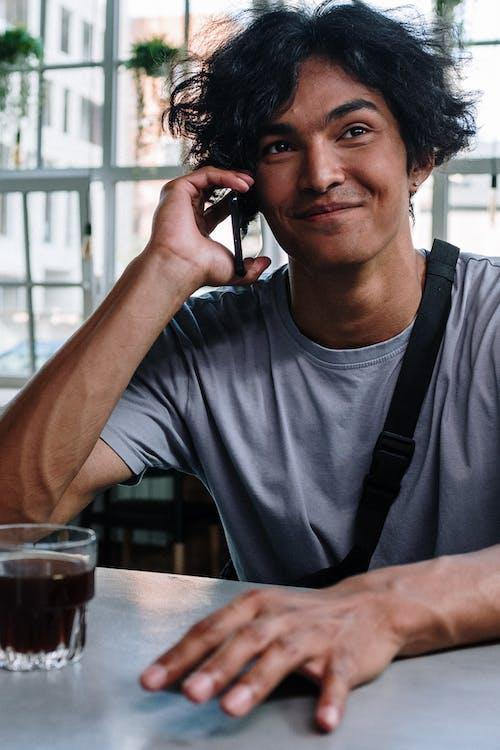 Man in Gray Crew Neck T-shirt Wearing Black Headphones