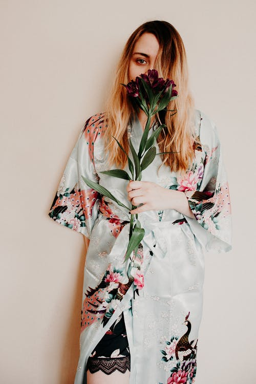 Woman in White Red and Green Floral Kimono