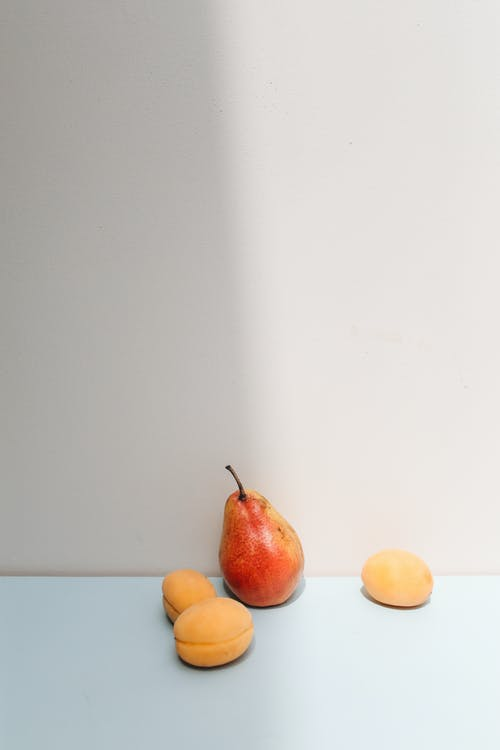 Red Apple Fruit Beside Orange Fruit