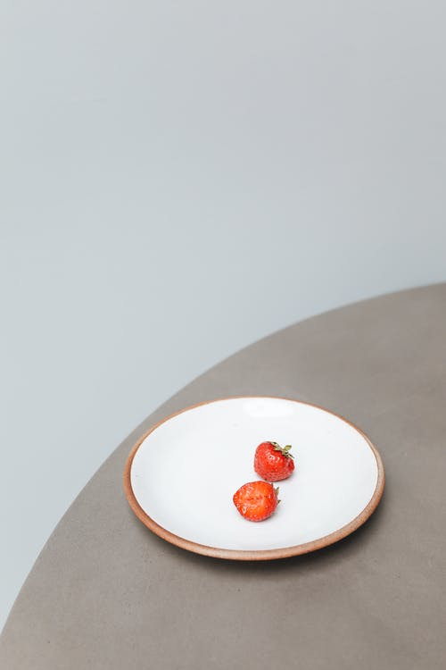 Red Round Fruit on White Ceramic Plate