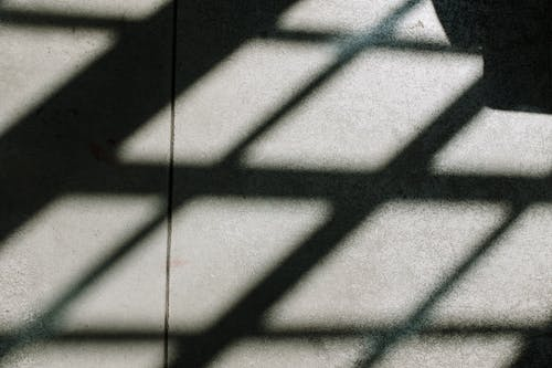 Shadow of Person on White Tiles