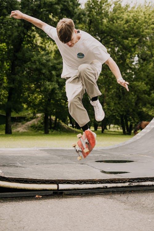 Man Doing Skateboard Tricks on Ramp
