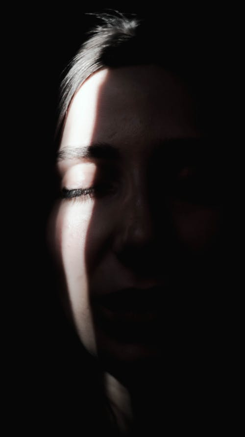 Womans Face With Black Background
