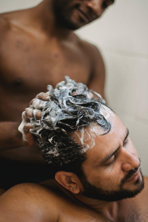 Man Washing Another Man's Hair