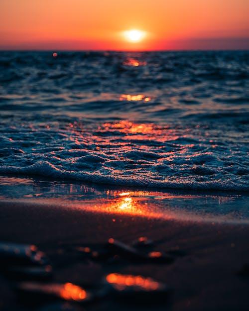 Waving sea at sunset time