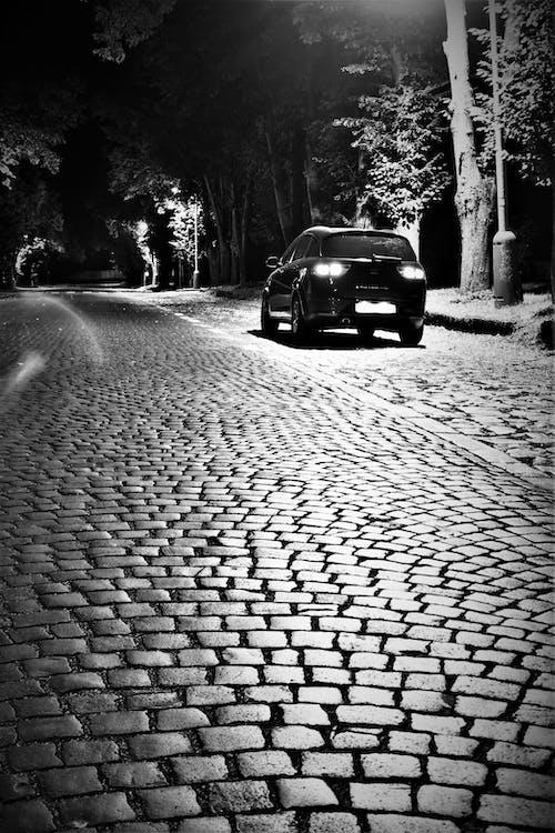 Free stock photo of black car, car, cobblestone, cobblestone street