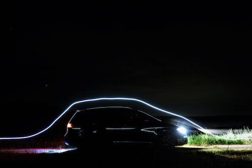 Foto profissional grátis de à noite, automóvel, carro, carro preto