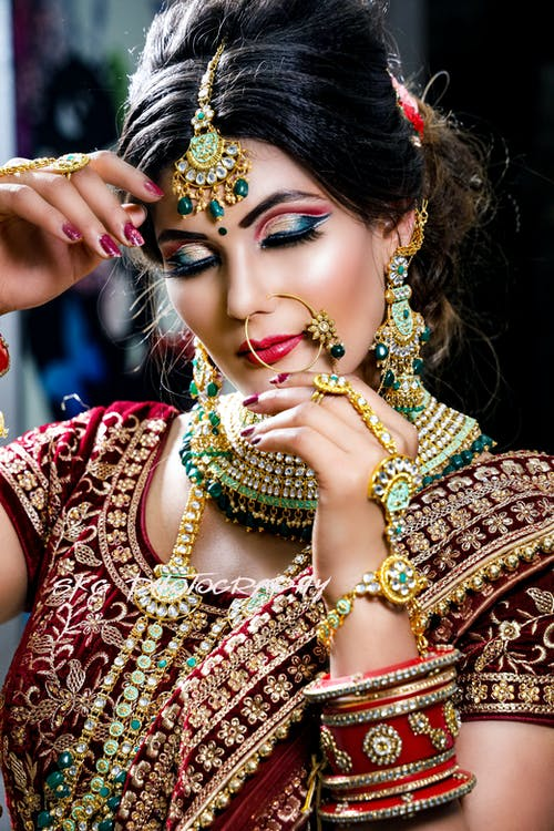Calm Indian bride with bright makeup