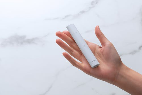 Person Holding White Power Bank