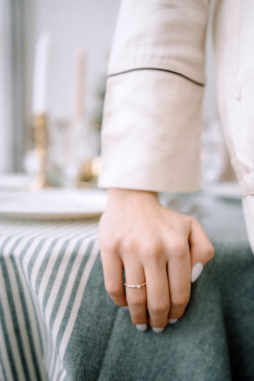 Crop married woman with ring at home