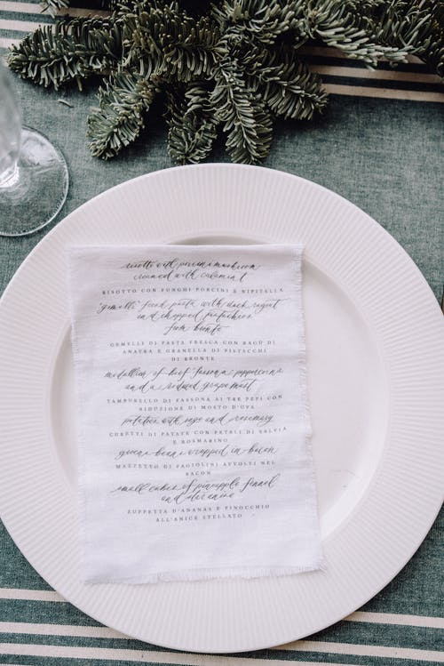 Plate with napkin on Christmas table