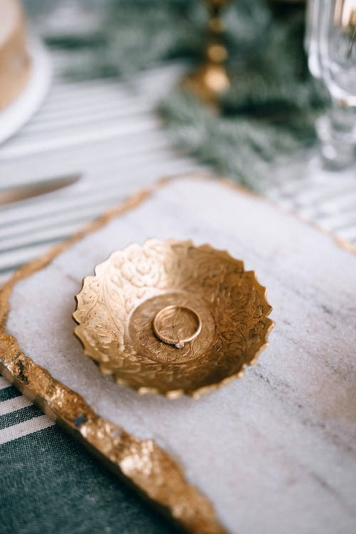 Elegant engagement ring on plate on table
